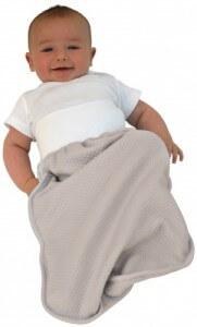 bébé dans un Cocobag couleur taupe